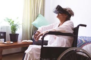 Senior woman using virtual realty headset at nursing home